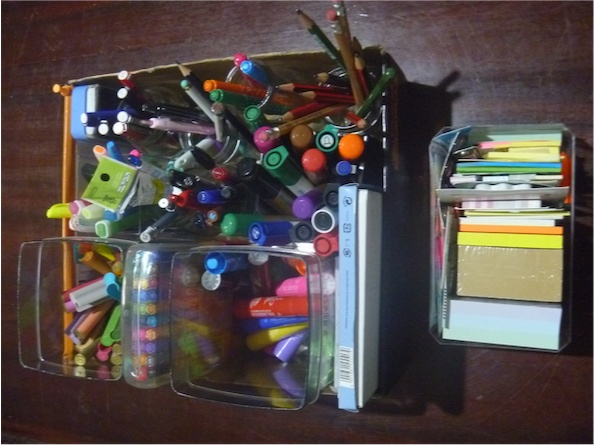 My organised collection of pens and post-it notes: No need to buy any more.